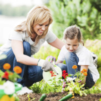 Front view of a mother and her daughter gardening.   [url=http://www.istockphoto.com/search/lightbox/9786778][img]http://dl.dropbox.com/u/40117171/family.jpg[/img][/url]  [url=http://www.istockphoto.com/search/lightbox/9786750][img]http://dl.dropbox.com/u/40117171/summer.jpg[/img][/url]